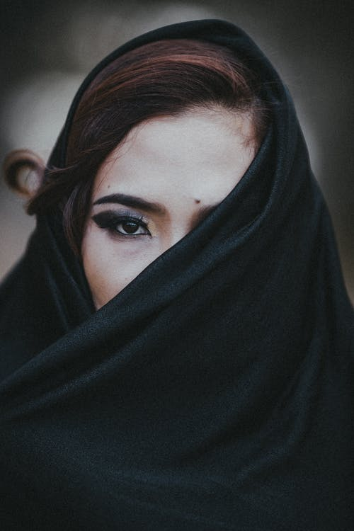 Woman Covering Face With A Scarf