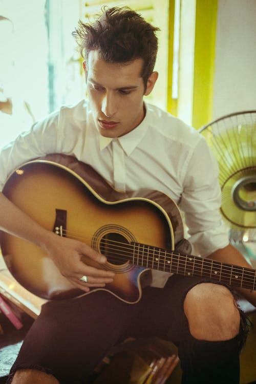 Man In White Dress Shirt Playing Acoustic Guitar