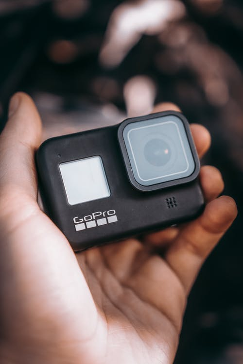 Person Holding An Action Camera