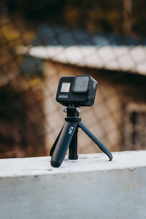 Black Camera On Tripod In Tilt Shift Lens