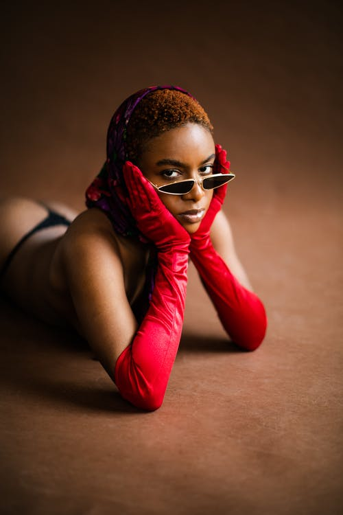 Woman in Red Satin Gloves Wearing Black Sunglasses