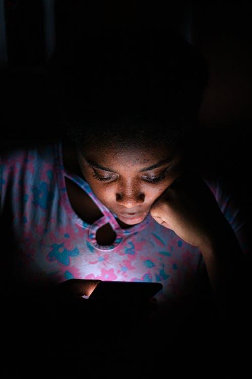 Person Using Smartphone in the Dark