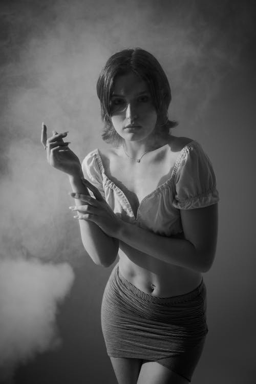 Grayscale Photo of Woman in Shirt