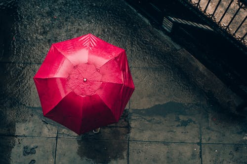 Red Umbrella on Gray Concrete Floor