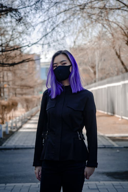 Unrecognizable ethnic woman in mask during COVID 19 pandemic
