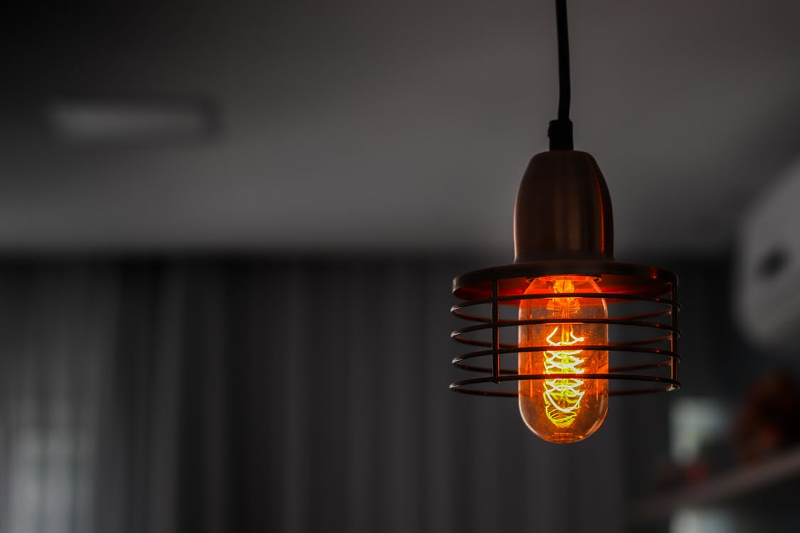 Orange Light Bulb Turned on in Close Up Photography