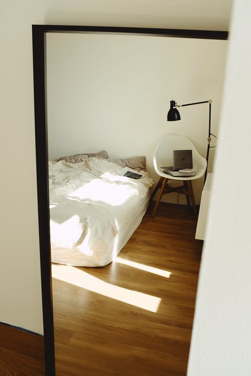 Black Framed Mirror on Bedroom Apartment Wall