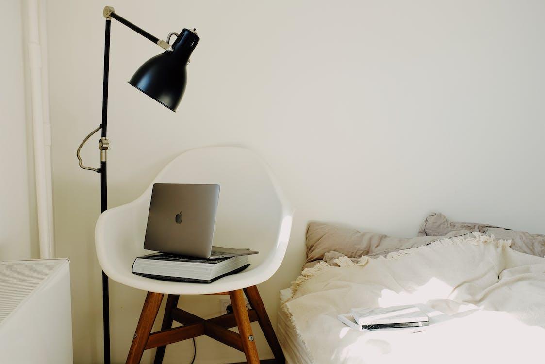 Black Lamp Beside White Chair