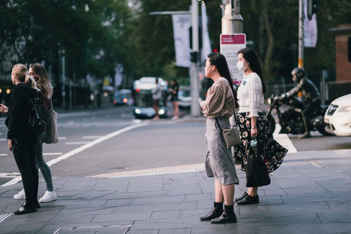 People Standing on Sidewalk