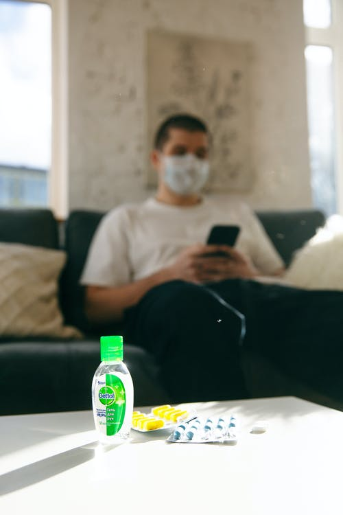 Man Sitting on the Couch Holding His Smartphone