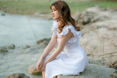 Elegant woman thoughtfully looking away in nature