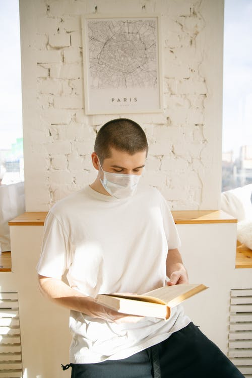 Man Wearing Face Mask While Reading