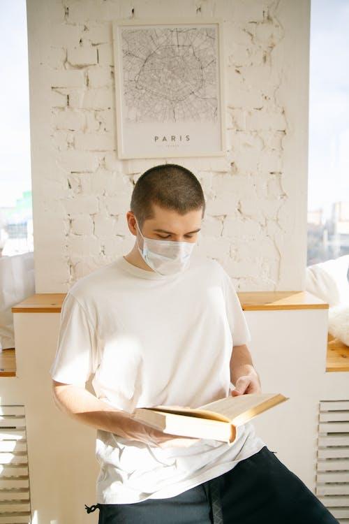 Man Wearing Face Mask While Reading