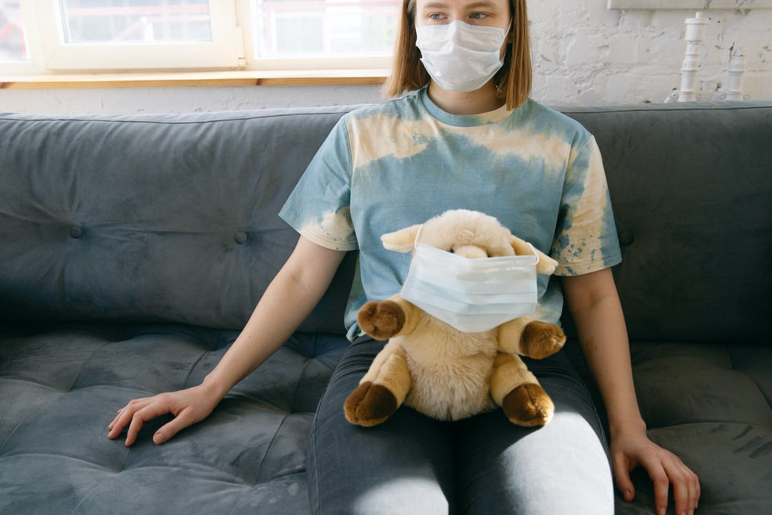 Woman with Her Stuffed Toy Wearing Face Mask