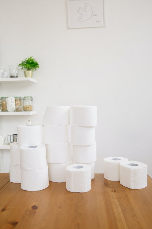 Bathroom Tissue Rolls on Wooden Table