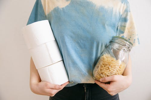 Person Holding Pasta Jar and Tissue Paper