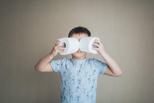 Little Boy Holding Tissue Roll