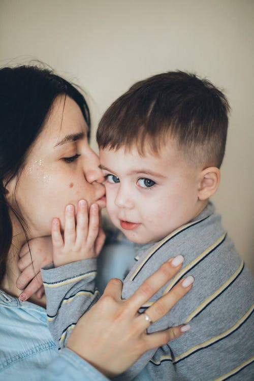 Mommy Kissing Little Boy