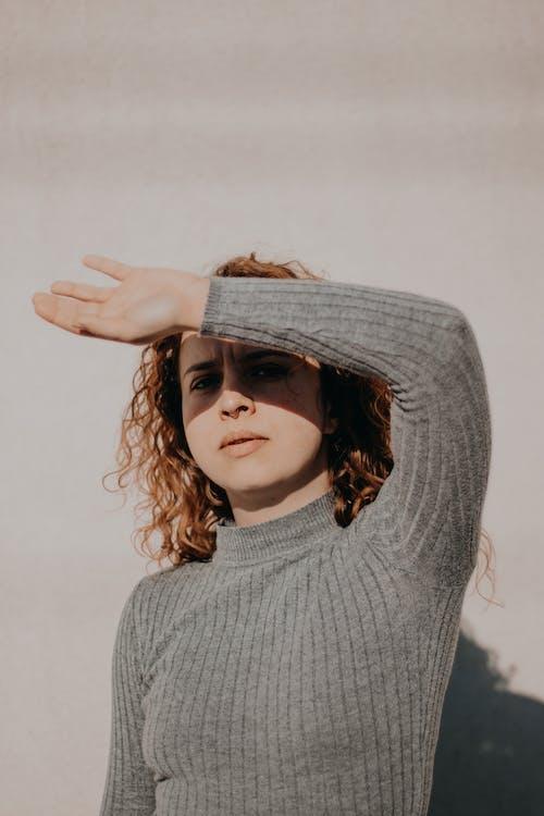 Woman in Gray Sweater Wearing Gray Sun Hat