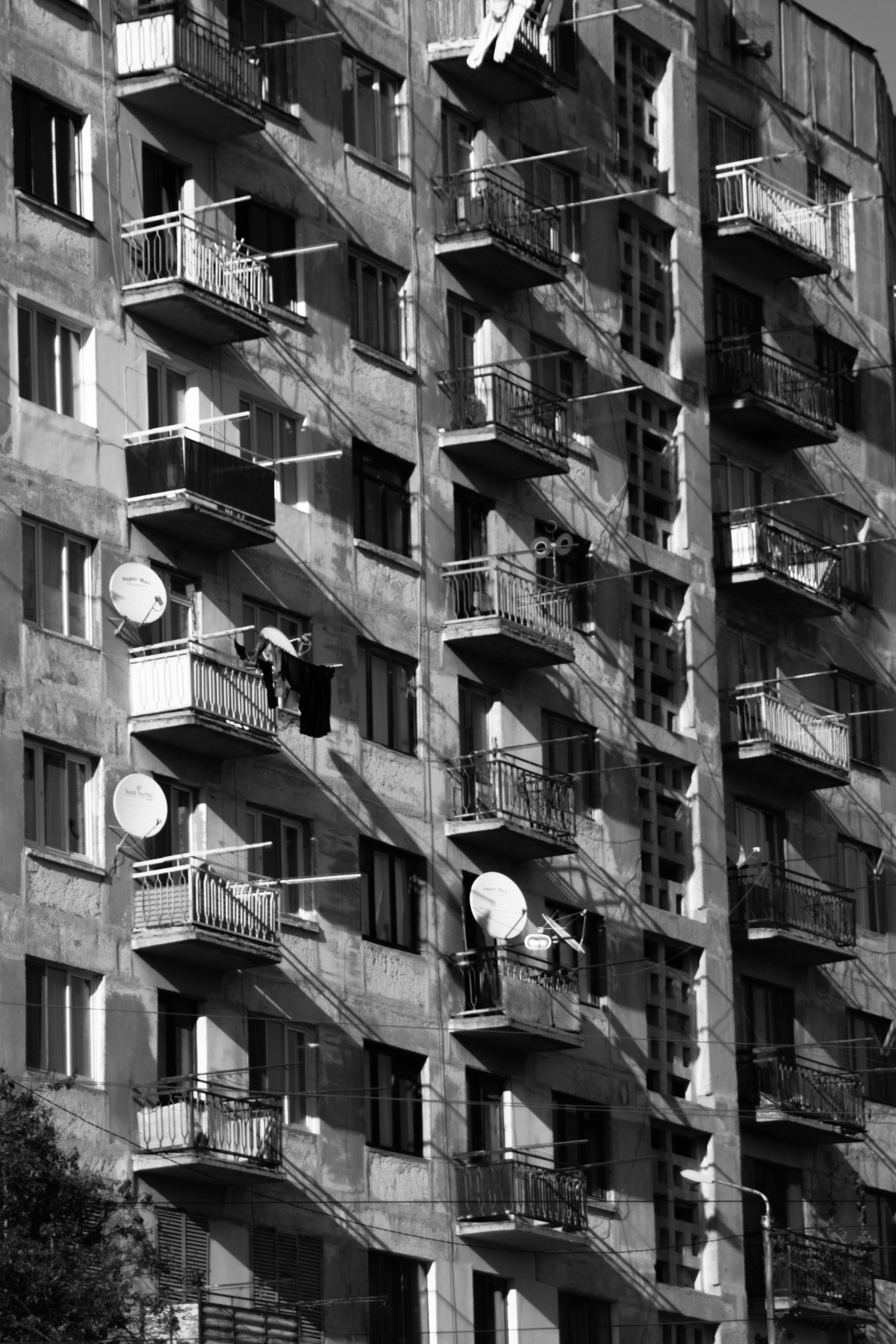 Free stock photo of balconies, shadows, urban