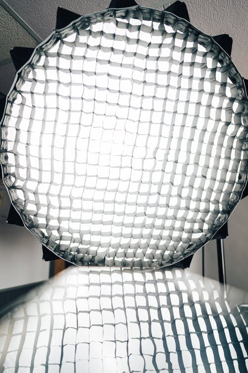 Honeycomb and softbox reflecting from metallic surface