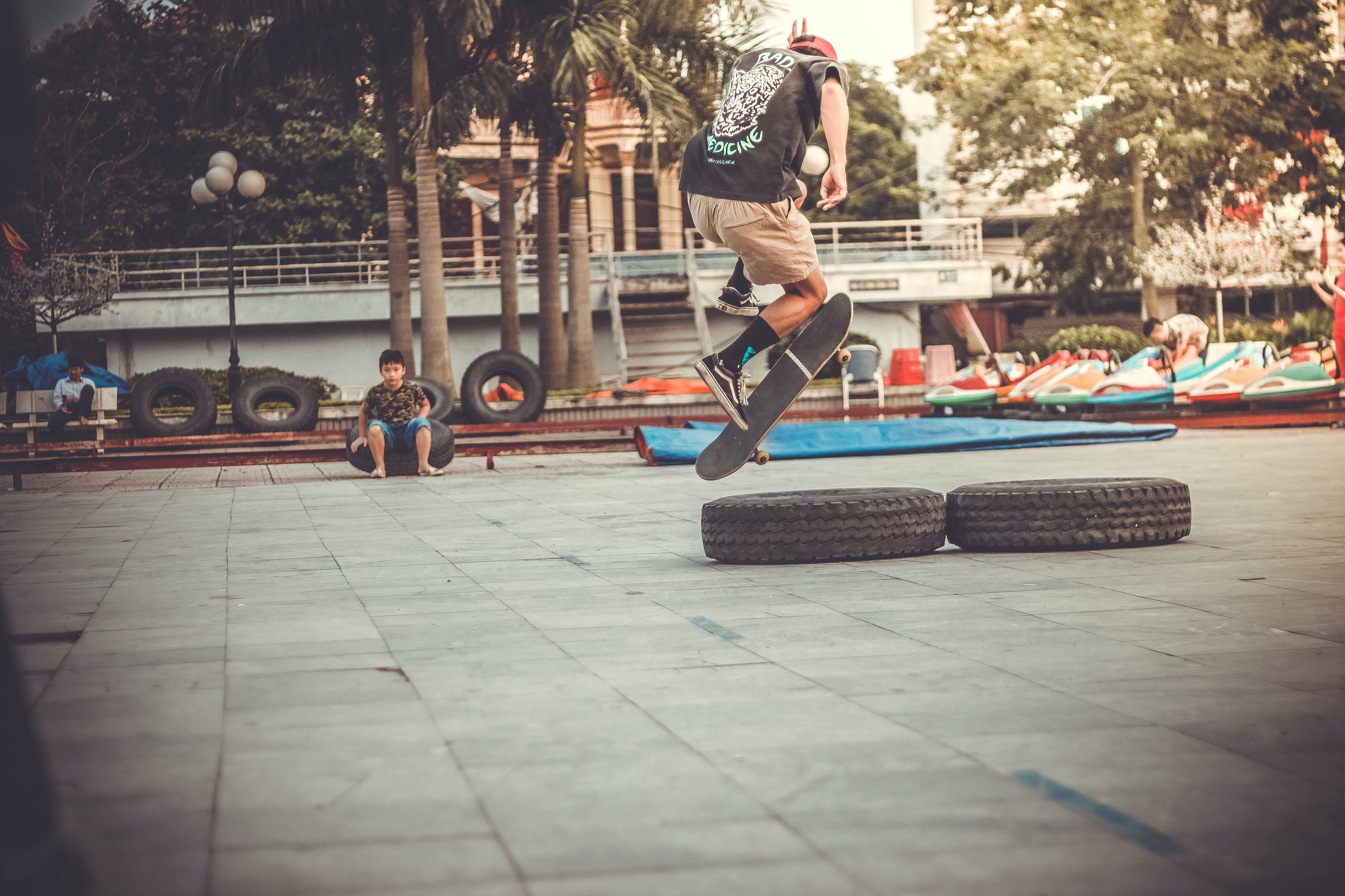 Man Playing Skateboard on Skate Park