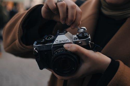 Photographer preparing old photo camera to take photo