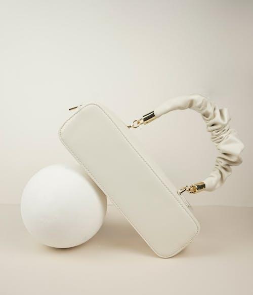 White Leather Long Wallet Beside White Egg