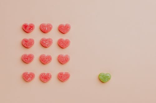Fruit jelly hearts on pink background
