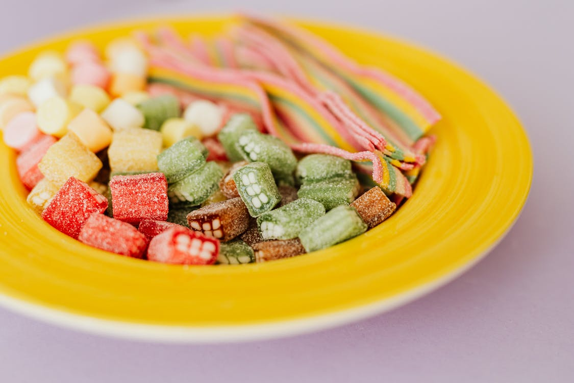 Tasty colorful gumdrops in plate