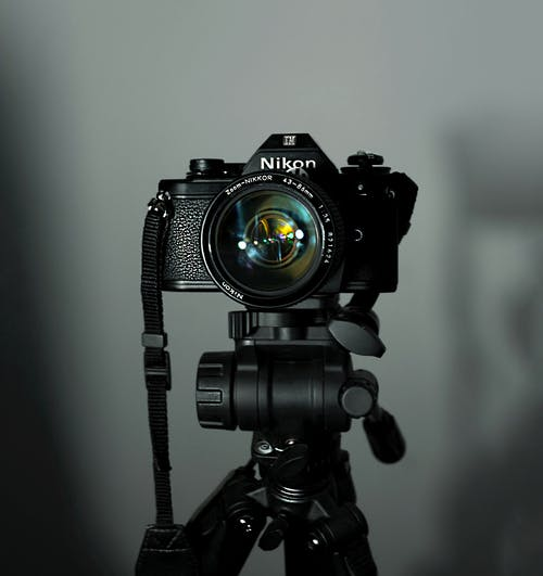 Black Nikon Dslr Camera on Black Tripod