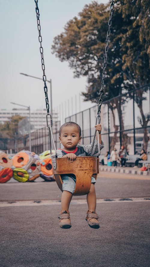 Boy Riding on Swing