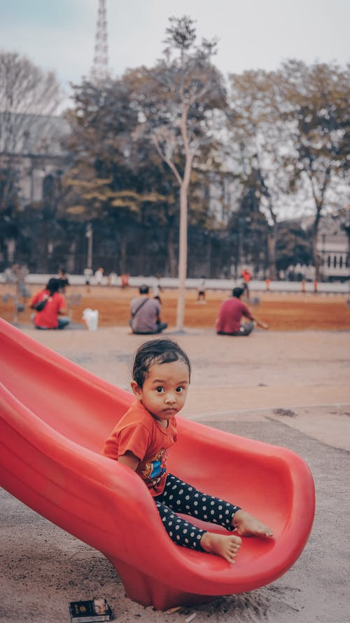 Little Girl in Red Slide