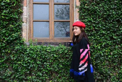 Woman Wearing Red Beret Hat Near Brown Window