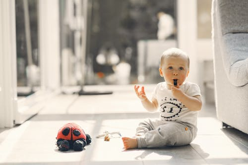 Little Boy Blowing a Whistle