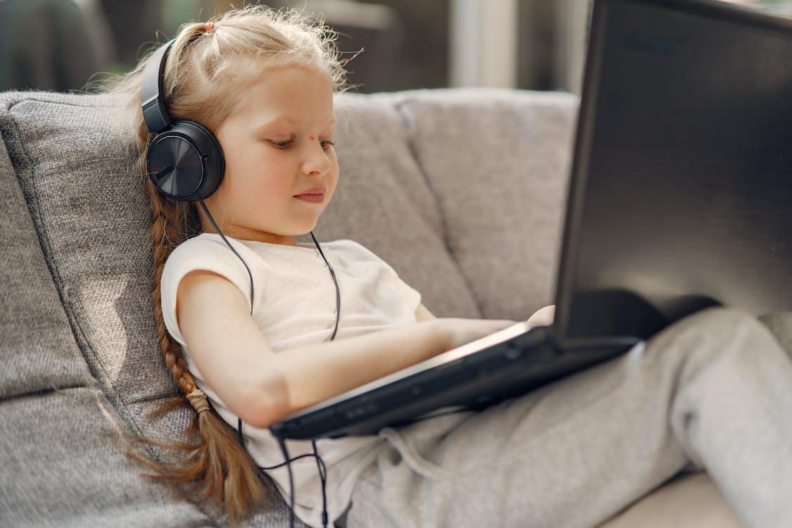 Little girl watching movie on laptop