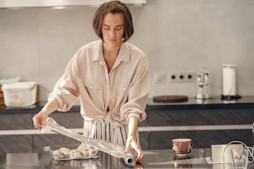 Woman Preparing For Dinner