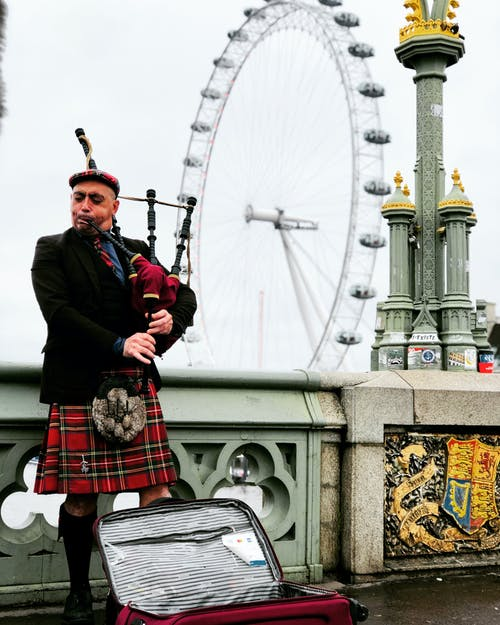 Musician in Scottish kilt in London