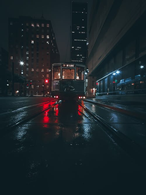 Tram Line on Road during Night Time