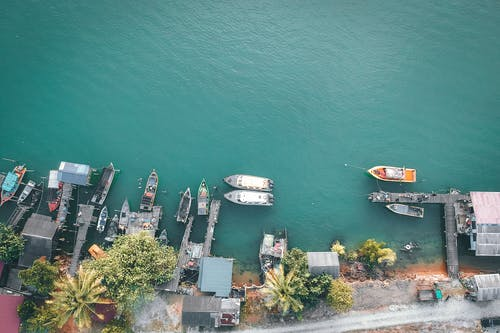 Aerial View of White and Red Boat on Body of Water