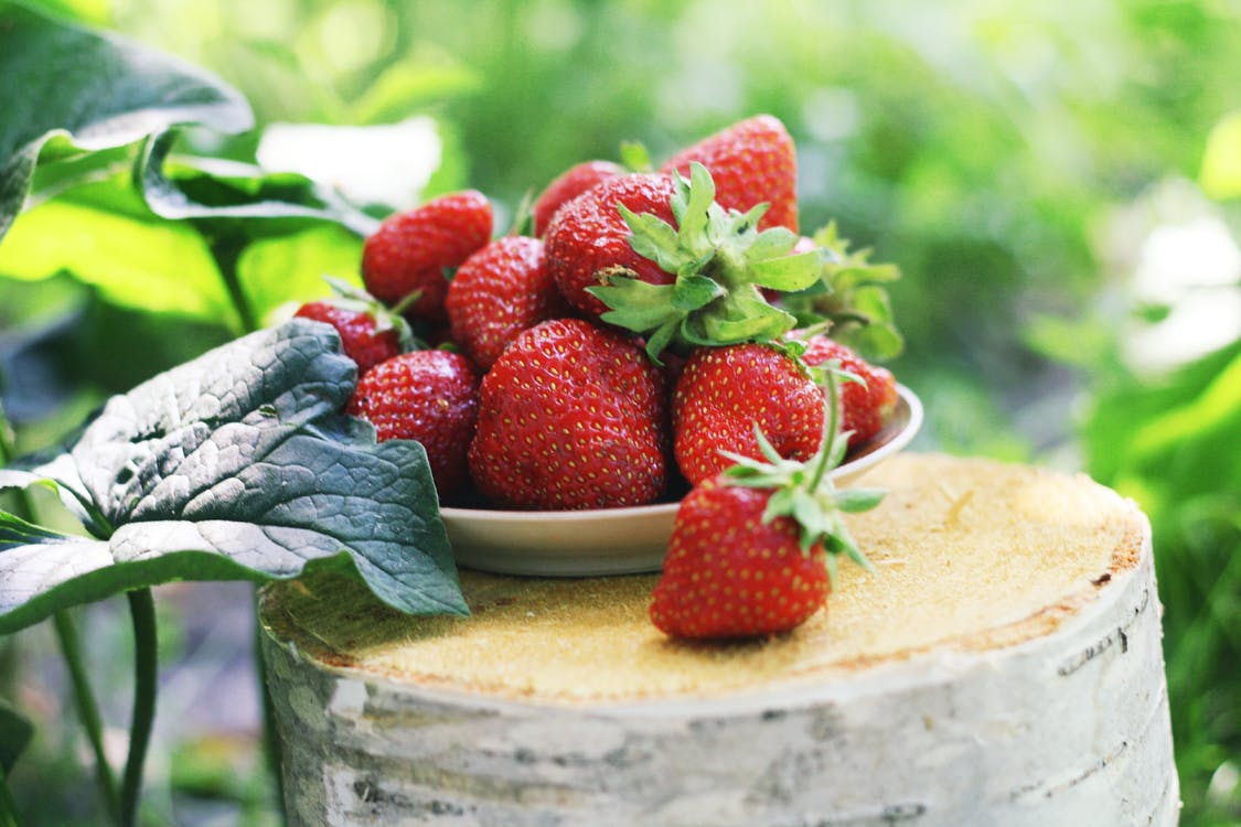 Red Strawberries on Brown Wooden Stump