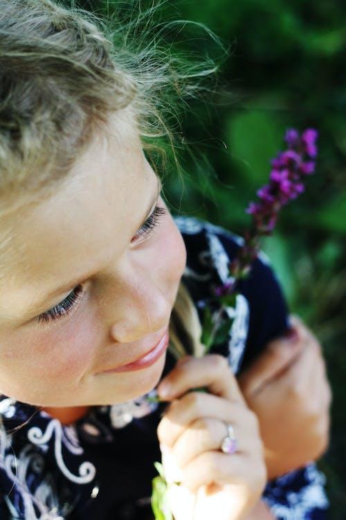 Girl Holding Lavender Flower