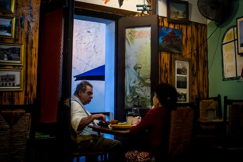 Free stock photo of locals, old couple, people eating, San Juan Puerto Rico