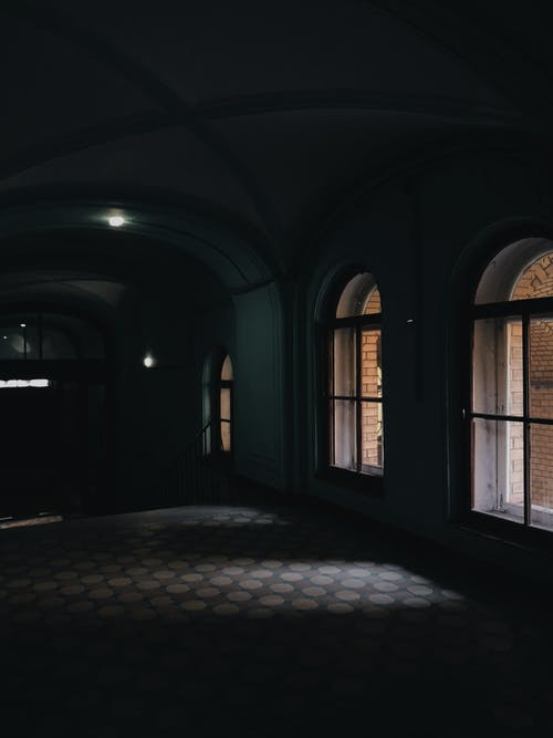 Dark room with arched windows