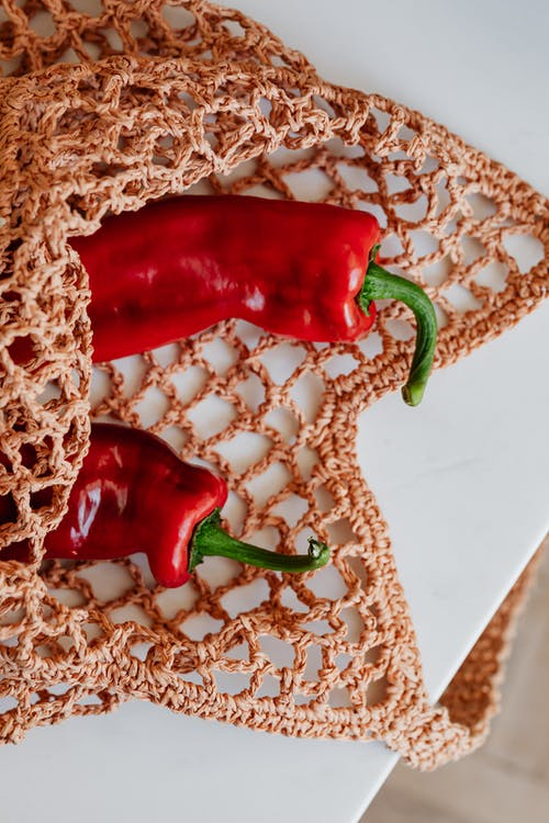Red Bell Pepper on White Lace Textile