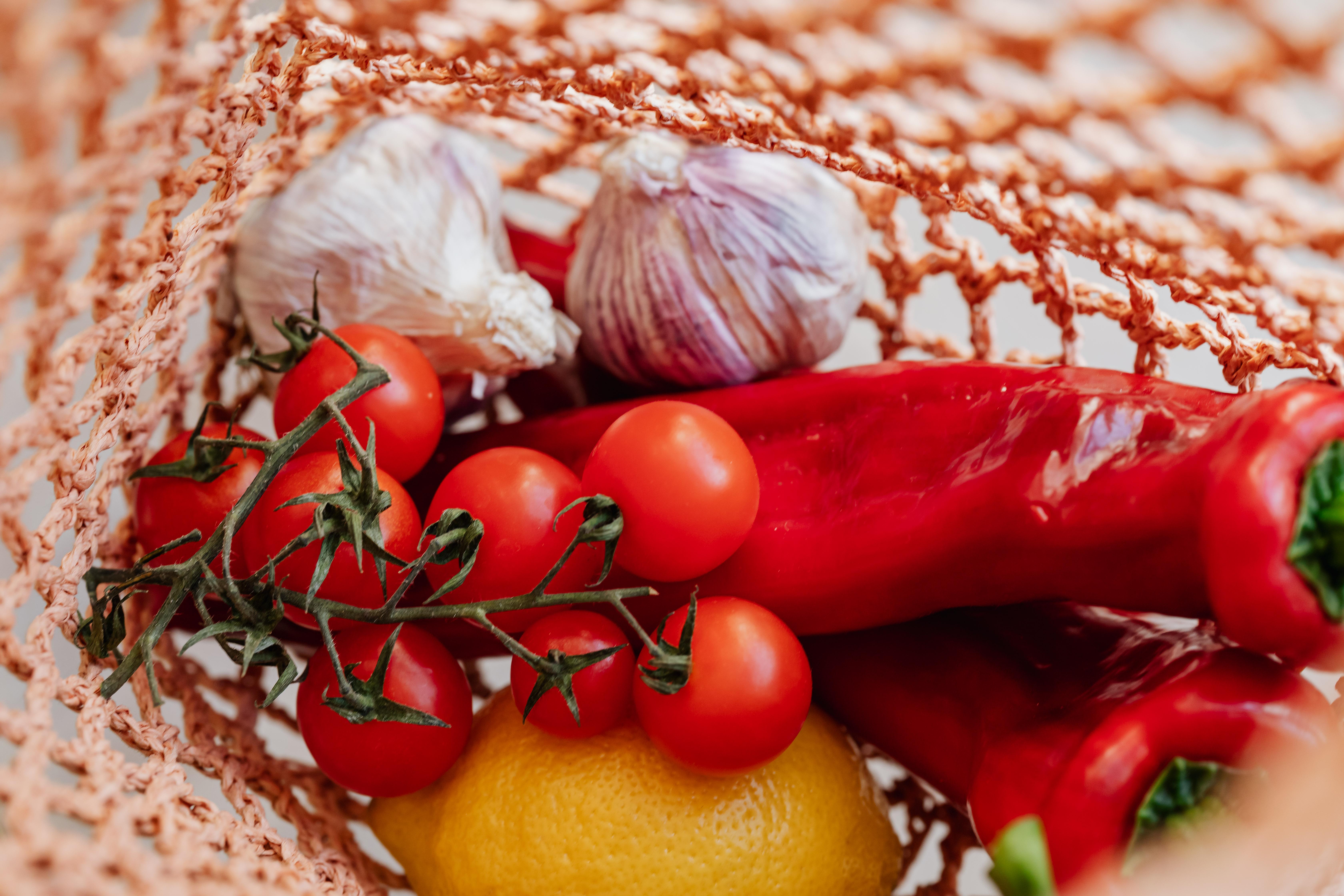 assortment of fresh vegetables with lemon in food net