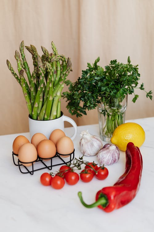 Set of fresh vegetables and eggs on table