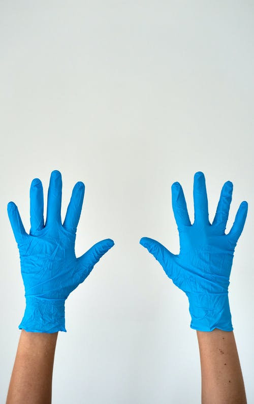 Persons Wearing Blue Gloves
