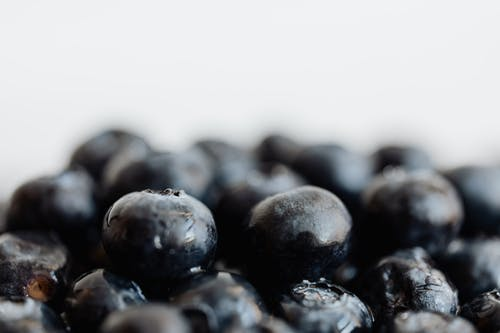 Bunch of delicious fresh blueberries on table