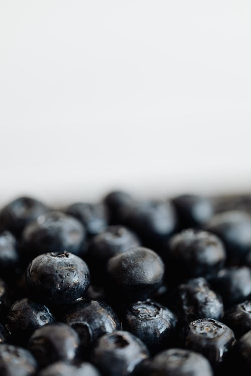 Pile of fresh ripe blueberries on table